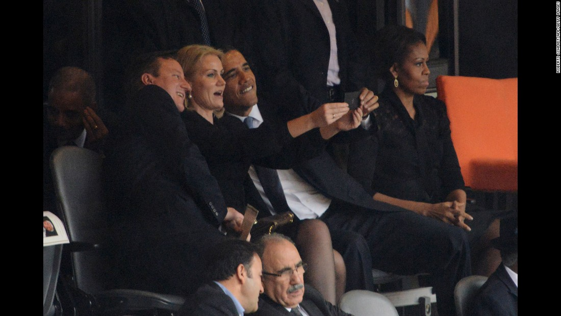"Obama and British Prime Minister David Cameron pose for a selfie with Danish Prime Minister Helle Thorning-Schmidt during Nelson Mandela's memorial service in Johannesburg on December 10, 2013. Some <a href=""http://politicalticker.blogs.cnn.com/2013/12/10/obama-takes-selfie-with-british-danish-prime-ministers/"" target=""_blank"">thought it was tasteless,</a> considering the occasion."