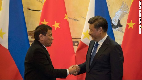 BEIJING, CHINA - OCTOBER 20: Philippine President Rodrigo Duterte, left and Chinese President Xi Jinping shakes hands after a signing ceremony on October 20, 2016 in Beijing, China. Philippine president Rodrigo Duterte is on a four-day state visit to China, his first since taking power in late June, with the aim of improving bilaterial relations.  (Photo by Ng Han Guan-Pool/Getty Images)