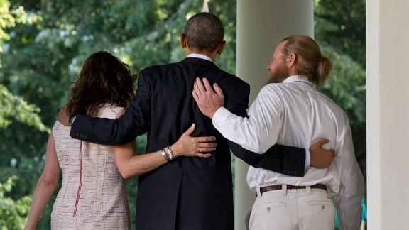 Obama, center, walks with the parents of Army Sgt. Bowe Bergdahl after making a statement about Bergdahl