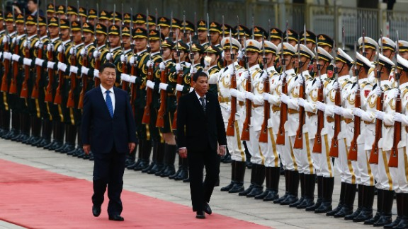BEIJING, CHINA - OCTOBER 20: President of the Philippines Rodrigo Duterte and Chinese President Xi Jinping review the honor guard as they attend a welcoming ceremony at the Great Hall of the People on October 20, 2016 in Beijing, China. Philippine President Rodrigo Duterte is on a four-day state visit to China, his first since taking power in late June, with the aim of improving bilateral relations.  (Photo by Thomas Peter-Pool/Getty Images)