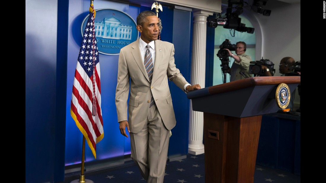 "Obama leaves the White House briefing room after speaking about various topics on August 28, 2014. But <a href=""http://politicalticker.blogs.cnn.com/2014/08/28/that-time-obama-wore-a-tan-suit-and-twitter-freaked-out/"" target=""_blank"">the reaction on Twitter</a> was largely focused on his rarely worn tan suit."