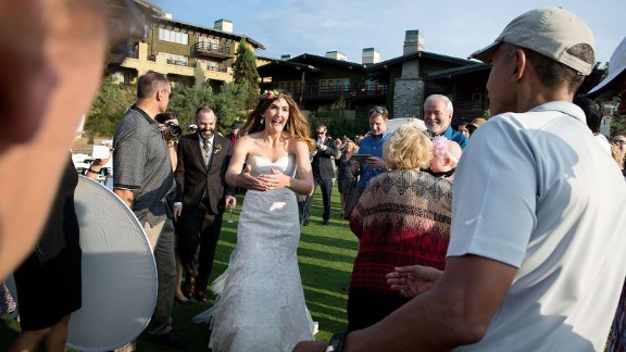 "Obama was playing golf in La Jolla, California, where a wedding ceremony was about to begin on October 11, 2015. ""The bride and groom were waiting inside, but when they looked out the window and saw the President, they decided to make their way outside,"" White House photographer Pete Souza said. Souza sent a copy of the photograph to the couple, Brian and Stephanie Tobe. ""Both wrote back to me that they were extremely grateful to have the President"