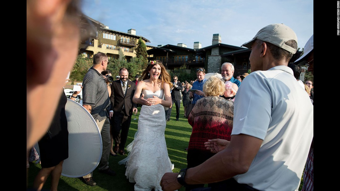 "Obama was playing golf in La Jolla, California, where a wedding ceremony was about to begin on October 11, 2015. ""The bride and groom were waiting inside, but when they looked out the window and saw the President, they decided to make their way outside,"" White House photographer Pete Souza said. Souza sent a copy of the photograph to the couple, Brian and Stephanie Tobe. ""Both wrote back to me that they were extremely grateful to have the President <a href=""http://www.cnn.com/2015/10/13/living/president-obama-crashes-california-wedding/"" target=""_blank"">'crash' their wedding.""</a>"