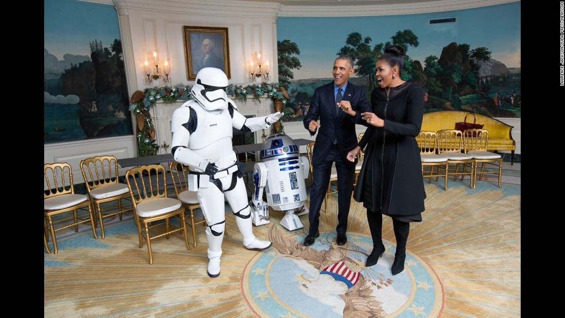 "The President and the first lady meet R2-D2 and a stormtrooper for a White House screening of the new ""Star Wars"" movie on December 18, 2015."