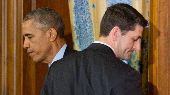 Obama walks past House Speaker Paul Ryan in Washington during a St. Patrick