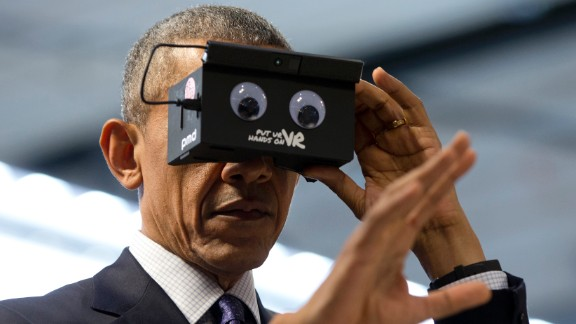 Obama tests virtual-reality goggles during a trade fair in Hanover, Germany, on April 25, 2016.