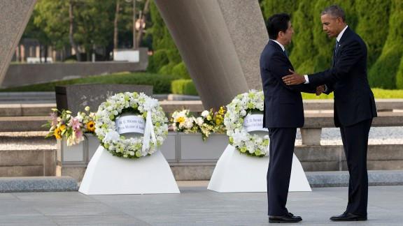 "Obama and Japanese Prime Minister Shinzo Abe shake hands after laying wreaths at the Hiroshima Peace Memorial Park in Hiroshima, Japan, on May 27, 2016. Obama, the first sitting U.S. President to visit Hiroshima, called for a ""world without nuclear weapons"" during his speech."