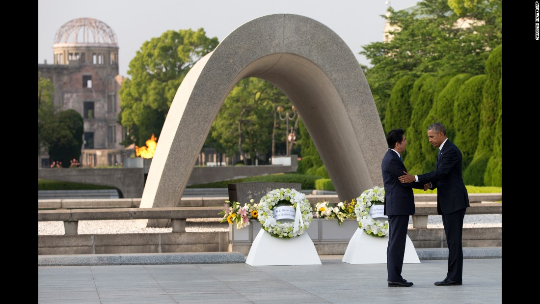 "Obama and Japanese Prime Minister Shinzo Abe shake hands after laying wreaths at the Hiroshima Peace Memorial Park in Hiroshima, Japan, on May 27, 2016. <a href=""http://www.cnn.com/2016/05/27/politics/obama-hiroshima-japan/"" target=""_blank"">Obama, the first sitting U.S. President to visit Hiroshima,</a> called for a ""world without nuclear weapons"" during his speech."