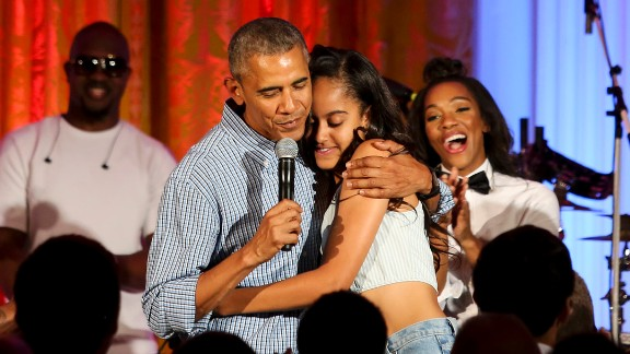 Obama hugs his daughter Malia at the White House Fourth of July party in 2016. She was celebrating her 18th birthday during the party, which included musicians Janelle Monae and Kendrick Lamar.