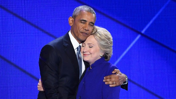 "Obama hugs Hillary Clinton after speaking at the Democratic National Convention on July 27, 2016. ""I can say with confidence there has never been a man or a woman -- not me, not Bill, nobody -- more qualified than Hillary Clinton to serve as president of the United States of America,"" Obama said."