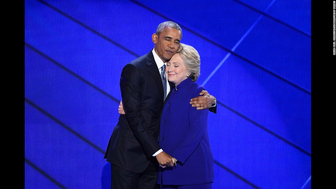 "Obama hugs Hillary Clinton <a href=""http://www.cnn.com/2016/07/27/politics/president-obama-democratic-convention-speech/"" target=""_blank"">after speaking at the Democratic National Convention</a> on July 27, 2016. ""I can say with confidence there has never been a man or a woman -- not me, not Bill, nobody -- more qualified than Hillary Clinton to serve as president of the United States of America,"" Obama said."
