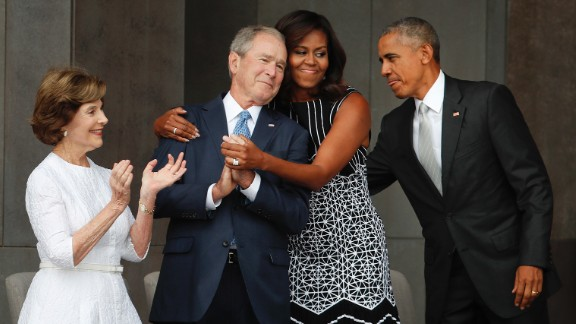 First lady Michelle Obama hugs former U.S. President George W. Bush during the dedication ceremony of the new Smithsonian museum devoted to African-American history. The museum opened in Washington on September 24, 2016. Read more: The friendship of Michelle Obama and George W. Bush