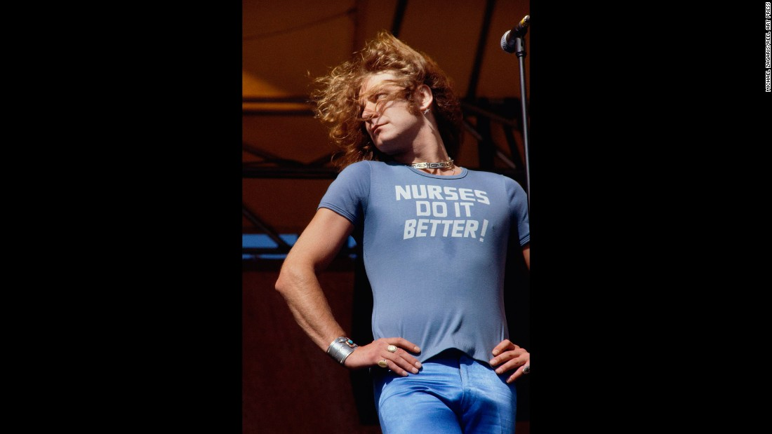 "Led Zeppelin lead singer Robert Plant performs in 1977. ""He epitomized the Dionysian dream that so many of the English bands and really that era of that type of rock music epitomized,"" Zagaris said. ""It was beauty, it was decadence, it was excess."""