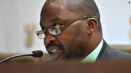 South Africa's minister of justice and correctional services, Michael Masutha, speaks to the press in Pretoria, South Africa, Friday, Oct. 21, 2016. Masutha said South Africa will soon submit a bill in parliament to withdraw from the International Criminal Court making the country the second this week, after Burundi, to move to leave the tribunal that pursues the world's worst atrocities. (AP Photo)