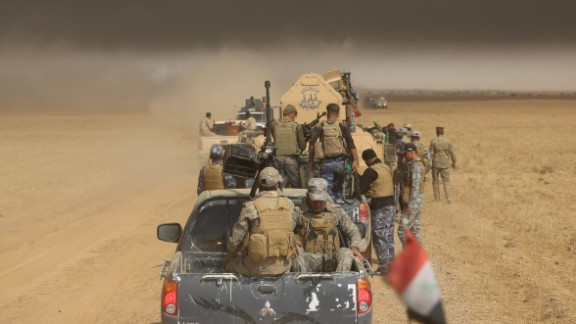 Iraqi army and militia forces arrive Thursday in Saleh village in the offensive to wrest Mosul from ISIS.
