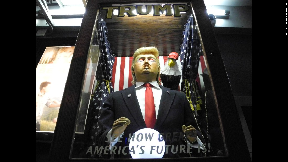 "A fortune-teller machine with a likeness of Donald Trump is seen at the New York premiere of the documentary ""Michael Moore in TrumpLand"" on Tuesday, October 18."
