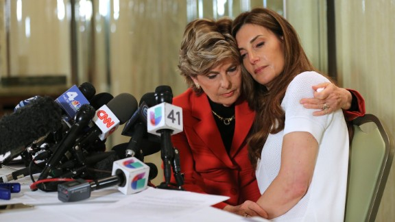 Attorney Gloria Allred, left, holds a news conference with Karena Virginia, who accused presidential candidate Donald Trump of grabbing her arm and touching her breast in 1998. Trump