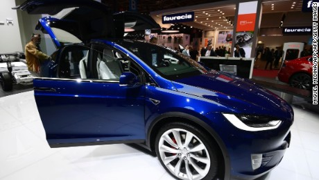 A man inspects a Tesla model X on September 30, 2016 in Paris during the Paris Motor Show.  / AFP / MIGUEL MEDINA        (Photo credit should read MIGUEL MEDINA/AFP/Getty Images)