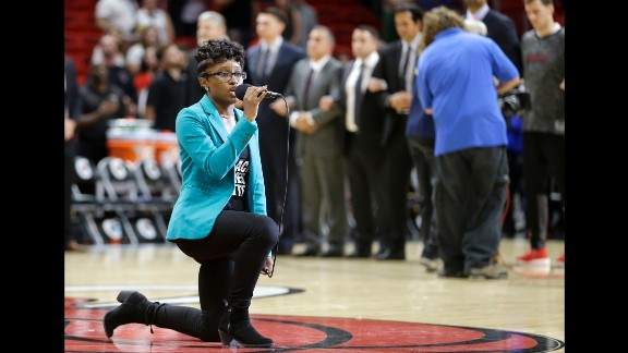 Denasia Lawrence performs the national anthem before an NBA preseason game Friday night in Miami.