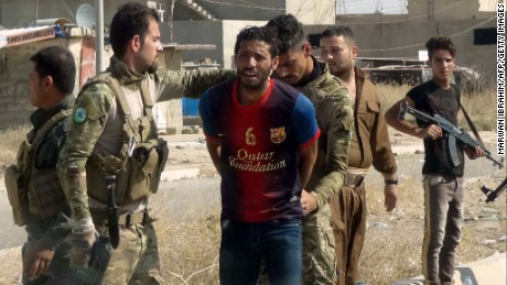 Iraqi Kurdish security forces detain a suspected ISIS fighter in Kirkuk on October 22.