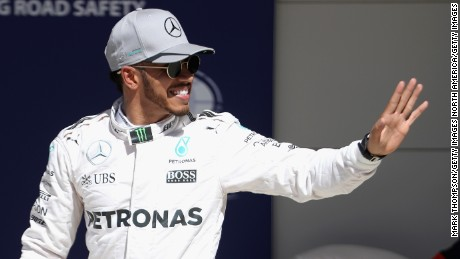 Lewis Hamilton waves after qualifying in pole position for the United States Grand Prix at Circuit of The Americas in Austin, Texas.