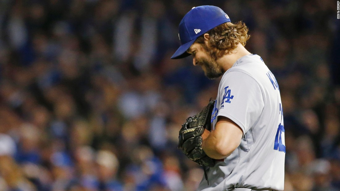 Los Angeles Dodgers starting pitcher Clayton Kershaw reacts after Chicago Cubs shortstop Addison Russell (27) hits a double during the second inning.
