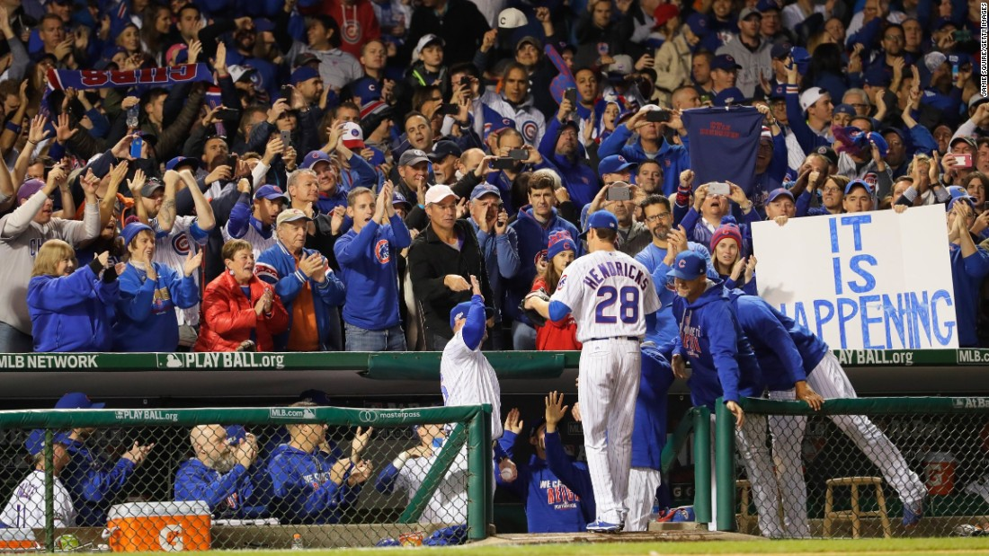 Cubs fans cheer as Kyle Hendricks is relieved in the eighth inning.