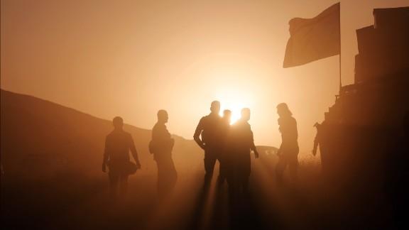 Kurdish Peshmerga forces take positions as they start to move toward the Imam Reza and Tizxirab villages of the Bashiqa district on Sunday, October 23.
