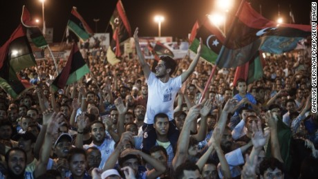 Tens of thousands of Libyans celebrate what the rebels claim to be the first uprising in Tripoli against the Kadhafi's regime on August 21, 2011 at freedom square in Benghazi, Libya. Several explosions and heavy gunfire were heard late Saturday in Tripoli, as witnesses reported fighting in some neighbourhoods of the Libyan capital.  Gunfire erupted in central Tripoli after the break of the dawn-to-dusk fast of Ramadan.   AFP PHOTO / GIANLUIGI GUERCIA (Photo credit should read GIANLUIGI GUERCIA/AFP/Getty Images)