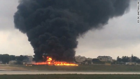 Smoke billows into the sky after a light plane crashed soon after takeoff from Malta airport, in Valletta.