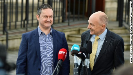 Gareth Lee, left, speaks outside Belfast high court Monday with Michael Wardlow of the Equality Commission.