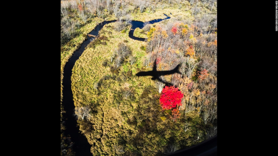 A shadow of Clinton's campaign plane is seen as the candidate prepares to land in Manchester, New Hampshire, on Monday, October 24.