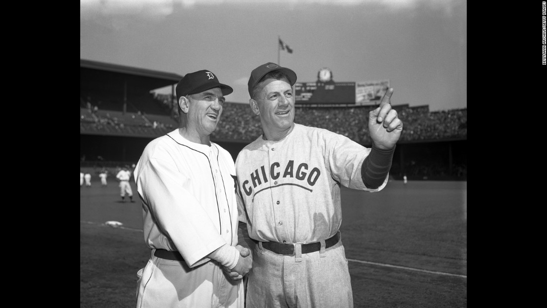 Detroit Tigers manager Steve O'Neill and Chicago Cubs manager Charley Grimm shake hands on the field at Briggs Stadium prior to the first game.<br /><br /><br />