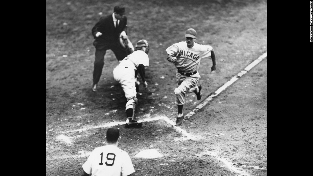 Cubs' Mickey Livingston scores a run past Detroit  catcher Paul Richards during game three of the 1945 World Series.