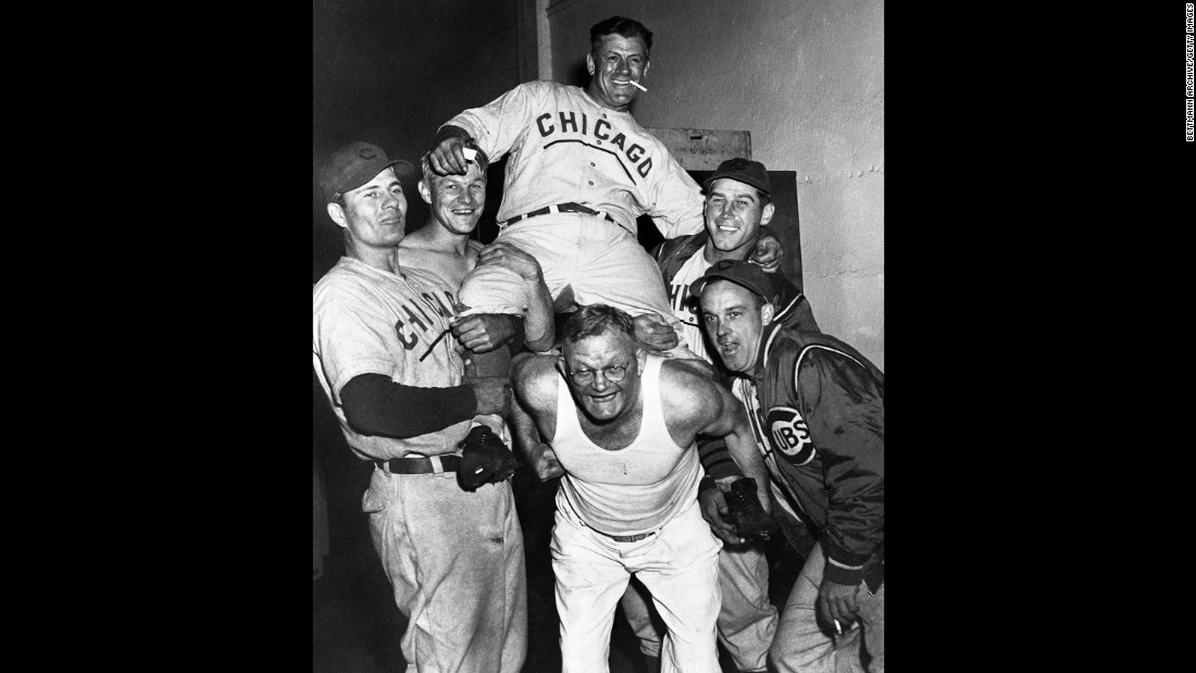 Chicago Cubs players hoist manager Charlie Grimm on their shoulders as they celebrate in the clubhouse after clinching the National League pennant on September 29, 1945. That year would be the last Cubs appearance in the World Series until 2016.