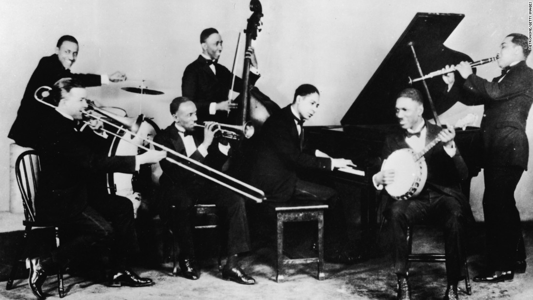 Jazz was in its infancy in 1908. Here's jazz pianist Jelly Roll Morton and his band, the Red Hot Peppers, around 1926.