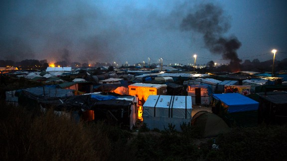 CALAIS, FRANCE - OCTOBER 24: Bonfires illuminate the night sky as night falls on the Jungle migrant camp on October 24, 2016 in Calais, France. French authorities have begun to clear the estimated 7000 people from the Calais Jungle migrant and refugee camp ahead of its demolition. (Photo by Jack Taylor/Getty Images)