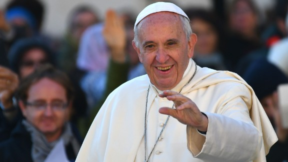 Pope Francis salutes the faithful upon his arrival in St. Peter