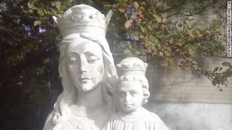 "The original stone head of baby Jesus head sits atop the statue. A temporary head, crafted by a local artist, was earlier mocked on social media. The head ""is now in a safe place until work is done,"" Father Gerald told CNN."