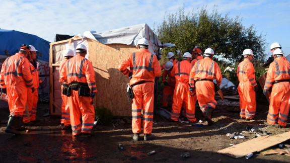 """Workers begin the demolition of the Calais """"Jungle"""" camp on Tuesday."""