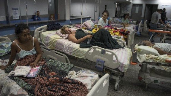 Patients lie on beds in the emergency room of a hospital in Barquisimeto on Monday, Feb. 22, 2016. In Barquisimeto, the hub of Venezuela's farming heartland, shoppers line up for food, neighborhoods are dark from rolling blackouts and hospitals are so crowded that the sick sometimes share beds.
