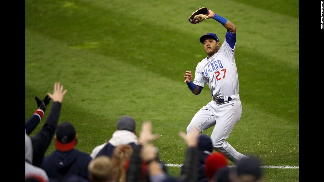 Addison Russell of the Cubs catches a ball hit by Cleveland's Jason Kipnis in Game 1.
