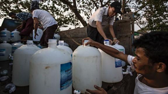 Volunteers prepare the clean water donation service in Dala, Burma.