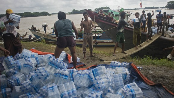 Volunteers load food supplies onto boats for flood-affected residents in Myanmar's Irrawaddy region in August 2015.