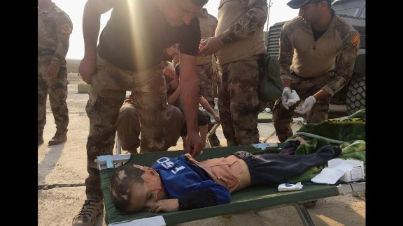 Soldiers give first aid to an injured boy in Tob Zawa on October 25.