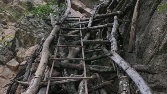School children had been forced to use unsteady vine ladders to reach their boarding school in the valley below.
