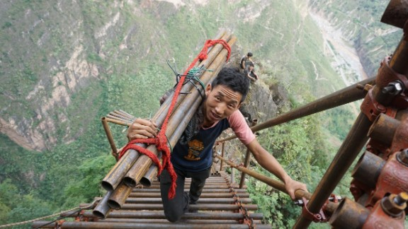 A mountain village on a cliff in southwestern China has been building a huge steel ladder to connect it to the outside world.