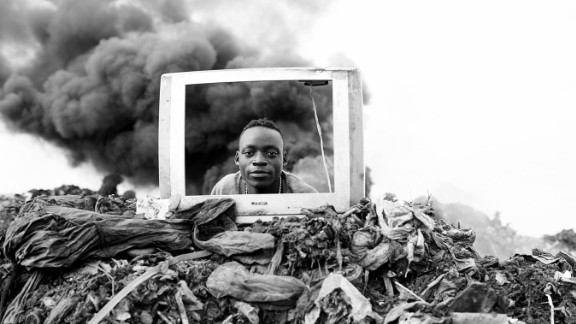 Phones are mainly disposed of in landfills and unauthorized markets.   Pictured: Profit Corner by Mario Macilau. A boy plays behind a discarded TV frame. Electronic waste is burned at the Maputo Municipal open pit dumpsite in Mozambique.