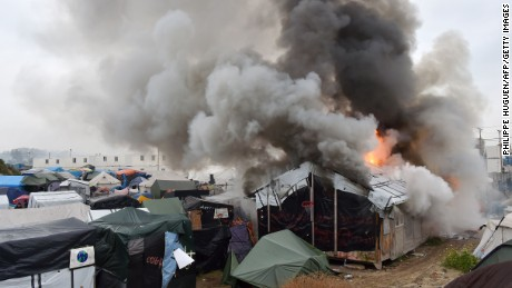 Migrants torched temporary shelters at The Jungle on Wednesday, authorities said.
