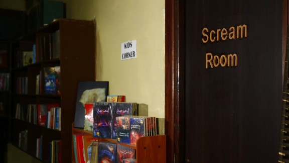 The scream room can be found right next to the smaller shelves by the children corner.